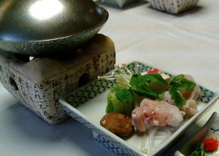Wakayama fish nabe with a small nabe hot pot and a dish of fish and other ingredients