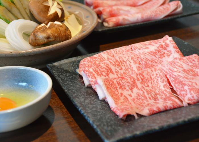 Wagyu sukiyaki -- thin strips of wagyu beef and vegetables to cook in a hot pot, with a raw egg for dipping