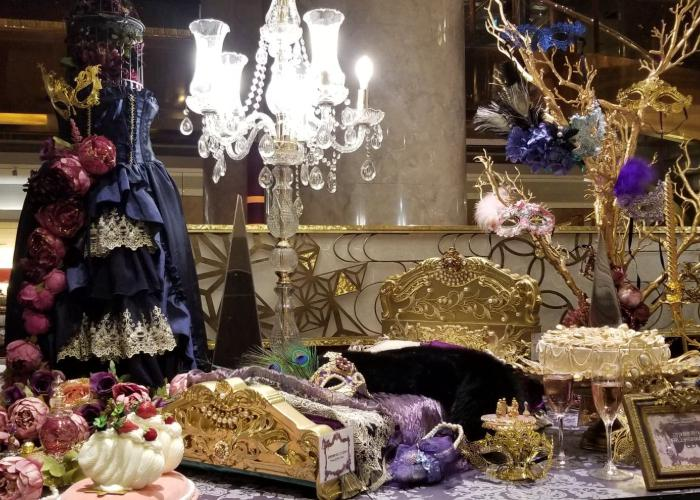 Hilton Tokyo's display for the Marie Antoinette Queen's Masquerade Afternoon Tea with a spread of masks and sweest
