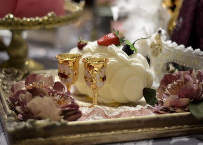 A platter with goblets, sweets, and lace, arranged at the Hilton Tokyo for the Marie Antoinette desserts buffet