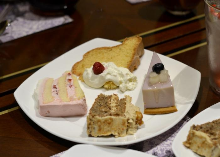 Hilton Tokyo Dessert Buffet Cake Selection: white plate with 4 slices of cake