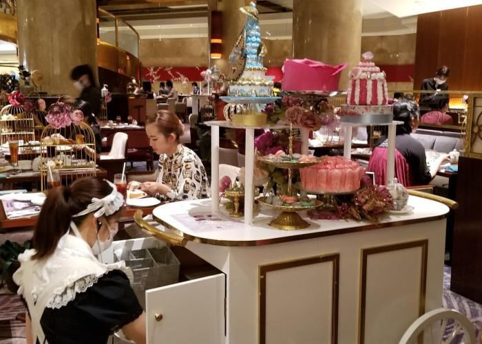 Server dressed in a maid uniform at the Hilton Tokyo dessert wagon
