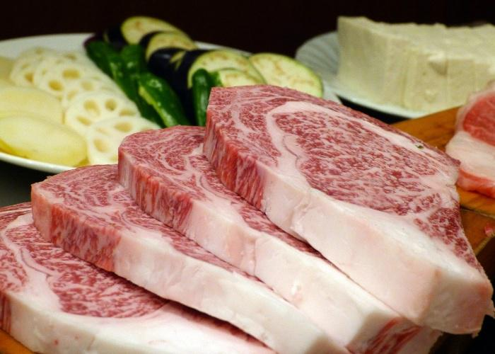 Several steaks of wagyu beef with marbled white fat