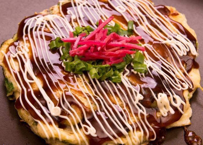 Kaikoko, Okayama specialty oyster okonomiyaki with a thick glaze of okonomiyaki sauce, drizzle of mayo, and pickled ginger beni-shoga