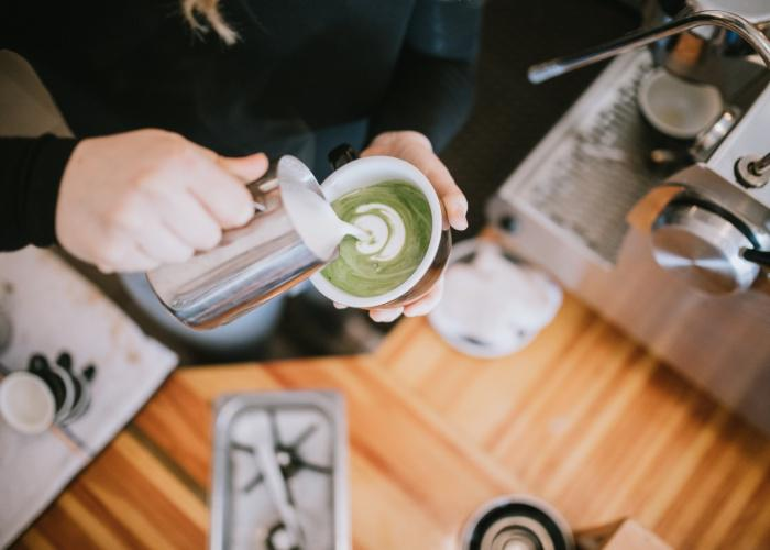 Matcha latte design being poured