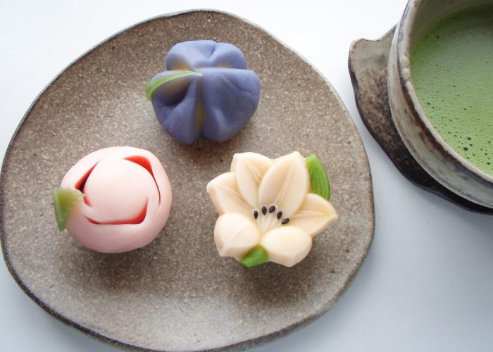 A plate with 3 nerikiri wagashi, Japanese confections, shaped like various flowers