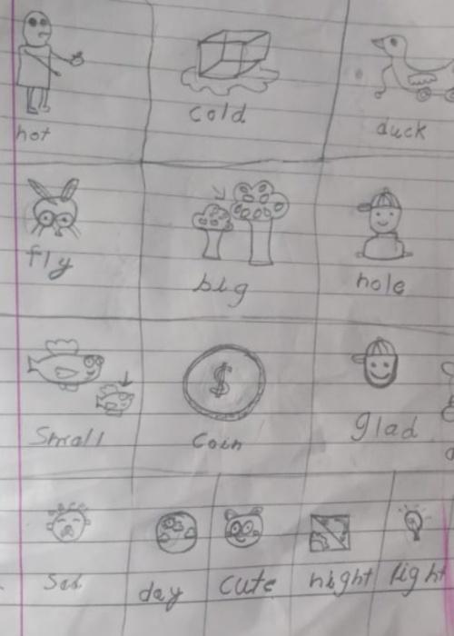 """Picture of a child's school assingment, labeling different pictures like """"fly"""" and """"big"""""""