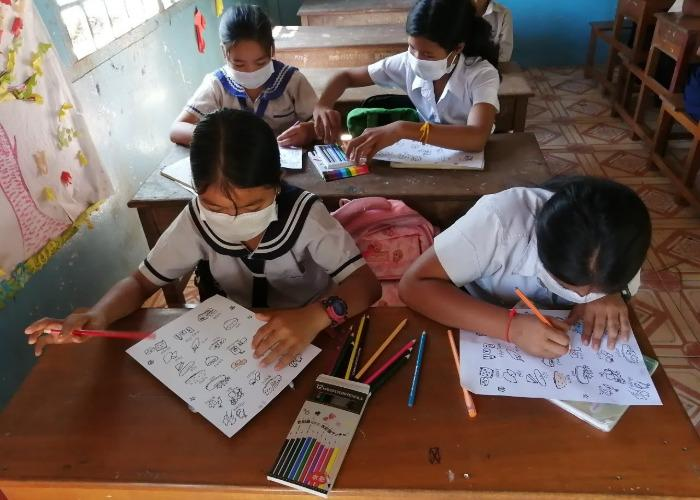 Cambodian children drawing during a nutrition workshop