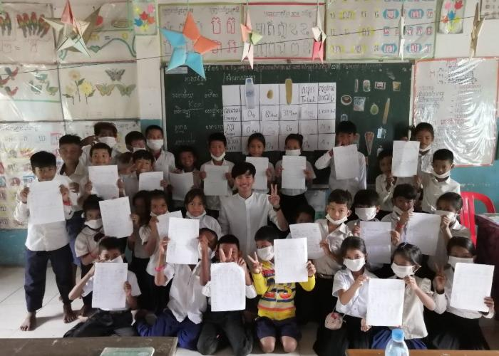 Classroom of children in Cambodia during a workshop with Nom Popok