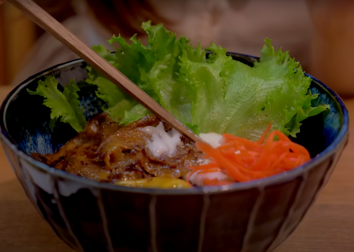 Asakusa Vegan Store's shougayaki donburi rice bowl with a vegan egg yolk