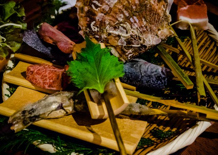 A selection of seafood on skewers ready to be grilled at Sanrokuen