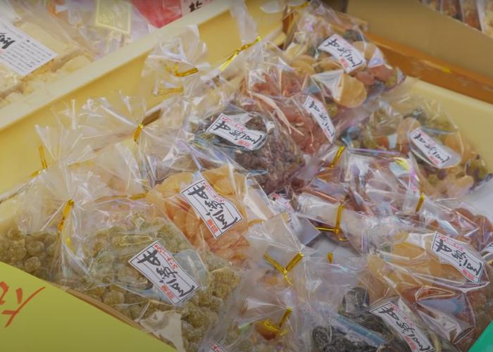 Display in a shop front selling different bags of traditional Japanese sweets such as amanatto