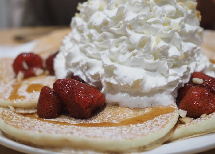 Pancakes topped with strawberries at Eggs N Things
