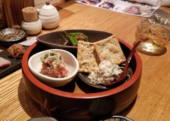 A big circular dish of appetizers from Robatasho, a robatayaki restuarant in Shinjuku, including kelp and mascarpone cheese and namerou
