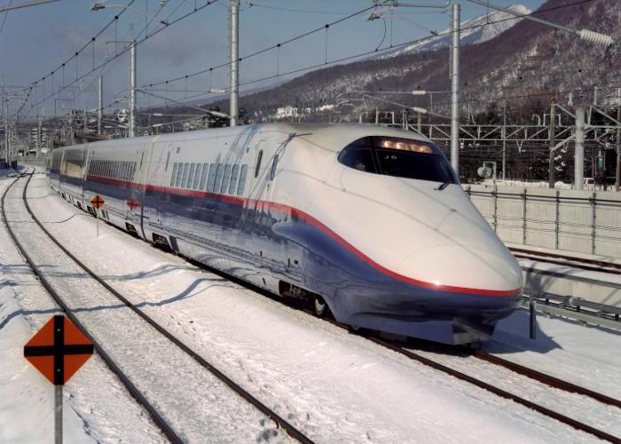 The Asama Karuizawa Shinkansen plowing through snowy land