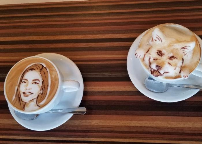 2D latte caricature of Shizuka Anderson and 3D latte art of a dog at Reissue