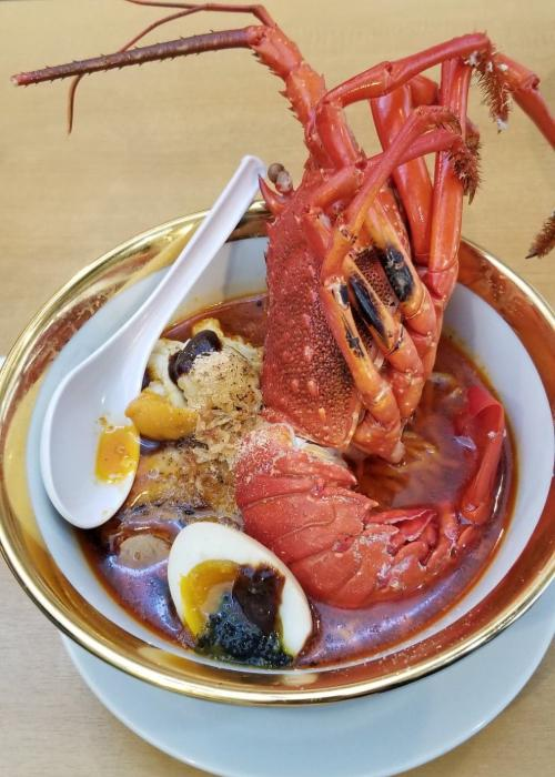 Bowl of massive lobster ramen from Oni Soba Fujiya Premium in Shibuya
