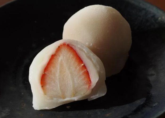 Close up of a strawberry mochi cut in half