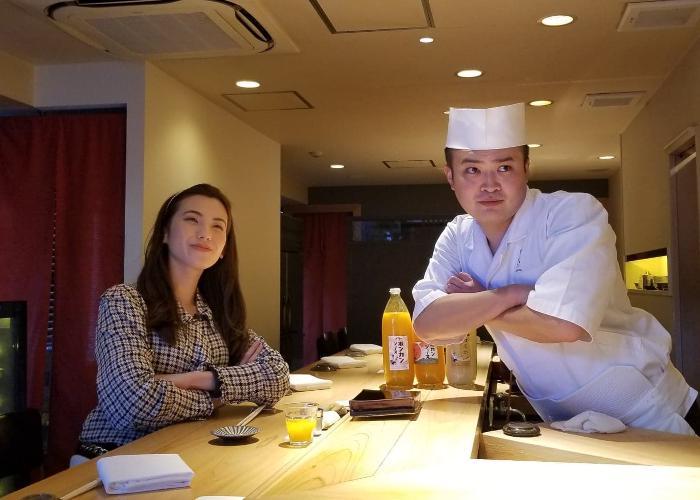 Shizuka and Chef Yuta at Sushi Rinda facing the camera, arms crossed