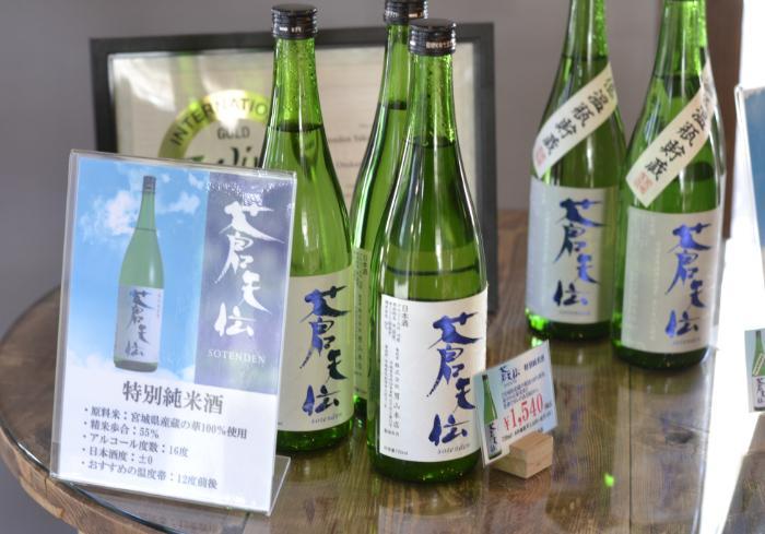 Green glass bottles of nihonshu at Otokoyama Honten Sake Brewery bottles