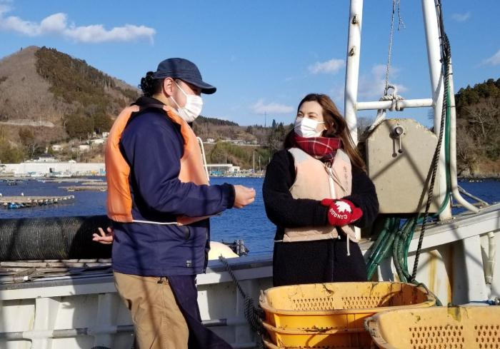 Sugawara HIroki and Shizuka Anderson on a boat for the Sake in the Sea experience