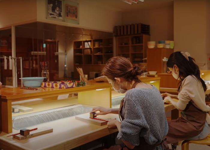 Shizuka and Leina making chopsticks at Miketsukuni Wakasa Obama Food Culture Museum
