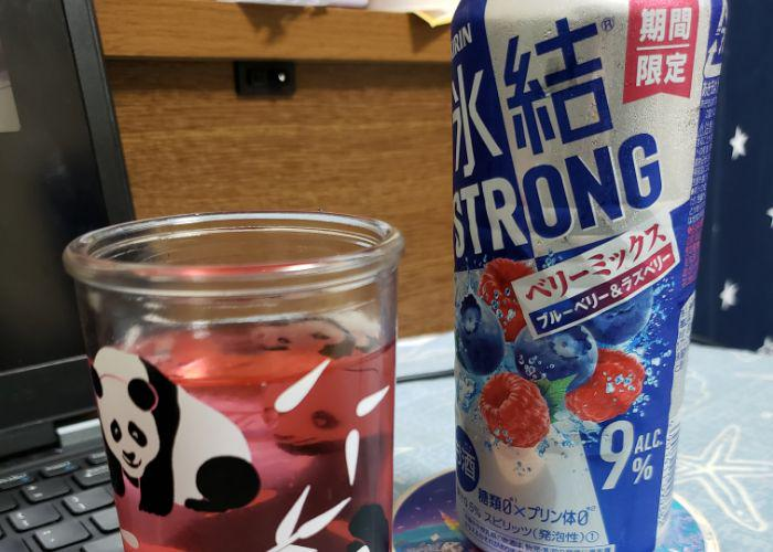 Tall can of mixed berry Kirin Strong chuuhai, pink chuuhai poured into panda glass