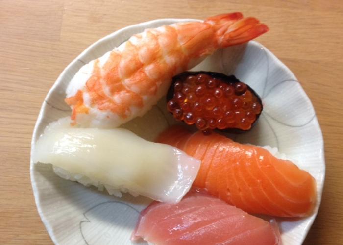 Assorted sushi plate with nigiri sushi like shrimp and ika