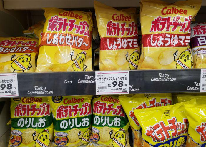 Packages of soy sauce mayo, shiawase butter, & nori Calbee chips on grocery shelves