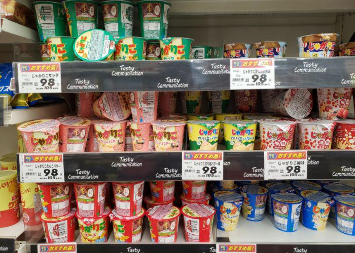 Cups of many different flavors of Jagariko on grocery shelves