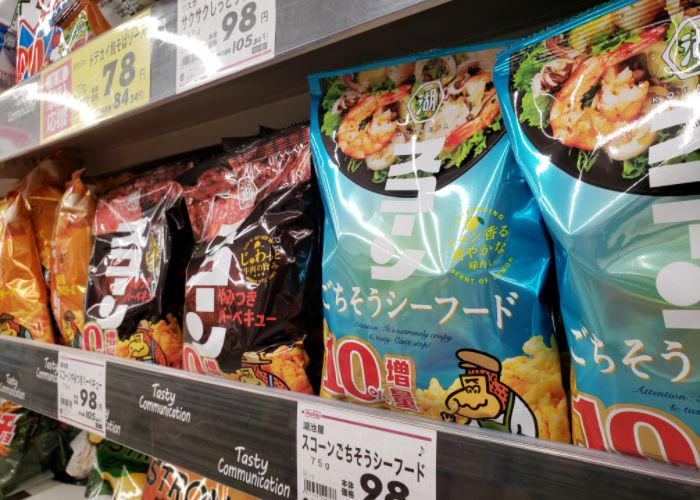 Packages of seafood and barbeque Sucorn on grocery shelves