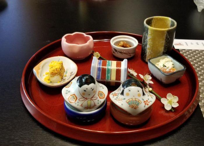 A red tray with a variety of Japanese tofu dishes at Tougakubou in Isehara, Kanagawa