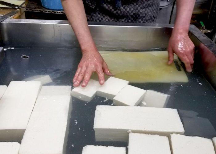 Blocks of tofu floating in water