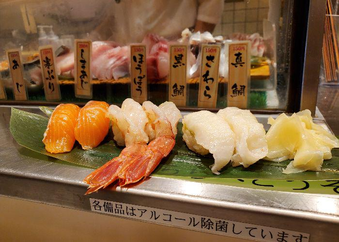 6 pieces of nigiri sushi including ebi sushi at Uogashi Nihonichi