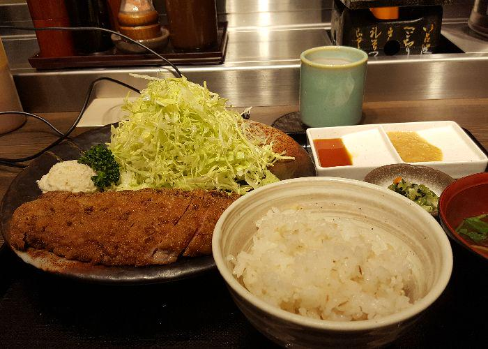 Beef katsu set with a bowl of rice and heap of cabbage at Gyukatsu Motomura