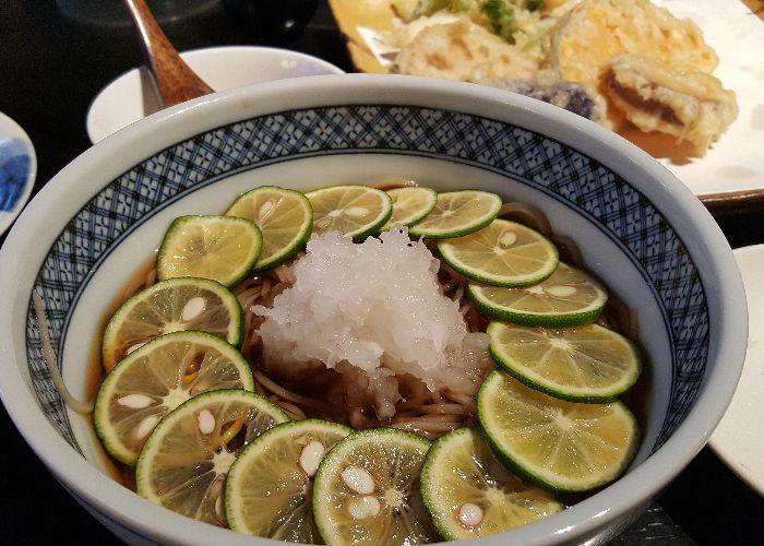 Sudachi soba, a bowl of noodles with slices of sudachi citrus lining the bowl