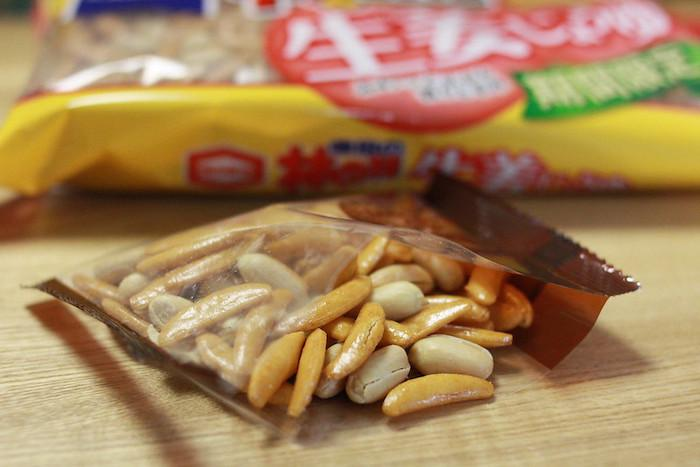 Kaki no Tane from Niigata, beer snack from Japan, the pack is open on a table with the main packet behind it