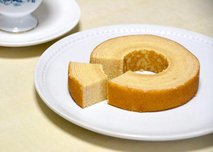 Baumkuchen from Shiga Prefecture on a plate, layer cake with a hole in the center