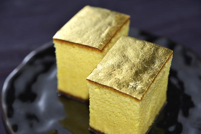 Castella Cake with Gold Leaf from Kanazawa in Ishikawa Prefecture on a plate with a dark background