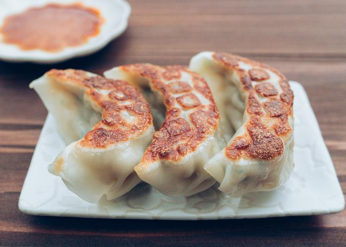 Utsunomiya gyoza, three pan-fried dumplings on a plate