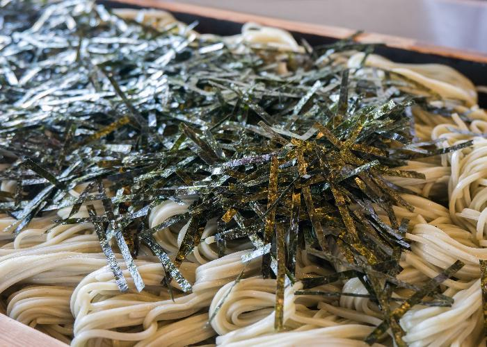A Niigata food specialty, hegi soba on a tray with nori sprinkled on top