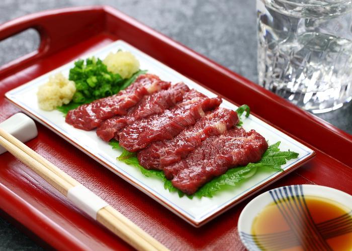Basashi, raw horse, on a plate served as sashimi