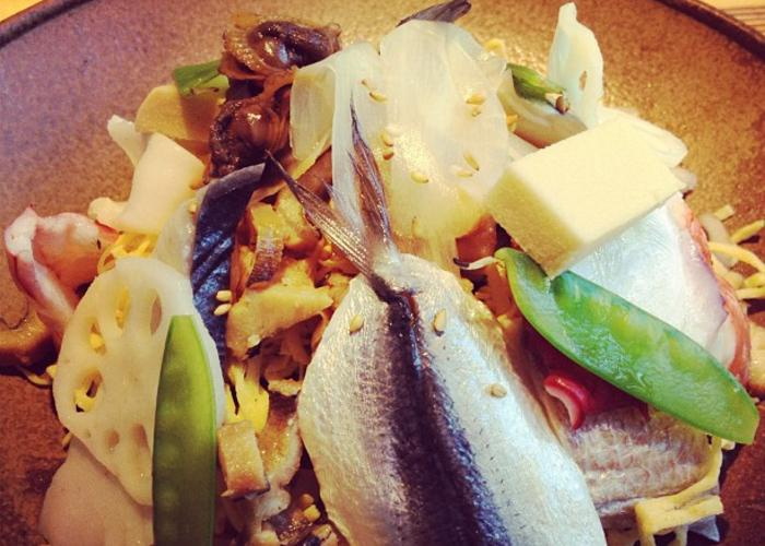 Barazushi, an Okayama specialty dish, with a bed of white rice topped with veggies and fresh fish