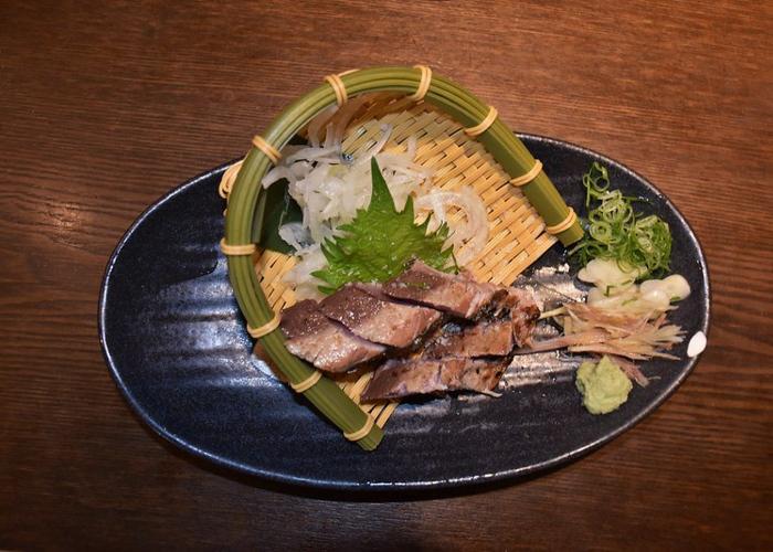 Glistening Katsuo no Tataki beautifully plated on a dish