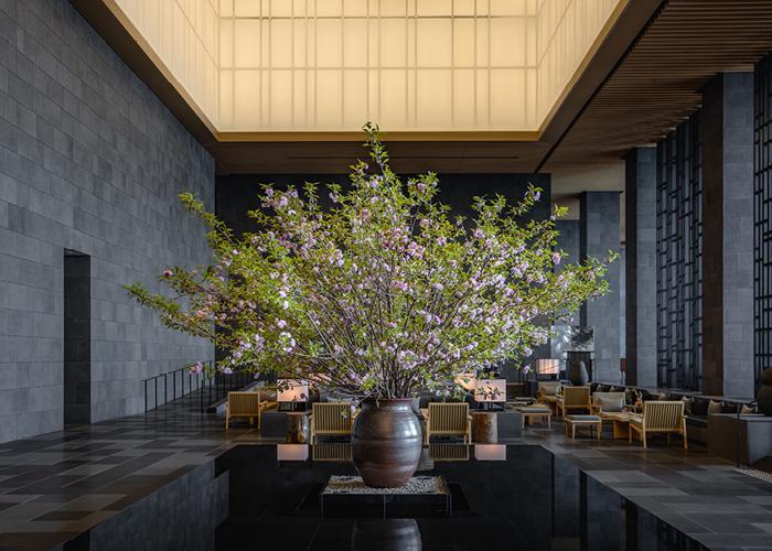 Image of Aman Tokyo lobby area with ikebana display