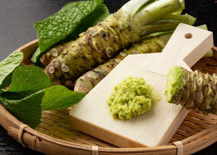 Real wasabi plant grated on a sharkskin grater