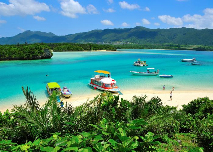 View of tropical Kabira Bay in Okinawa, with clear blue waters and a verdant green coast