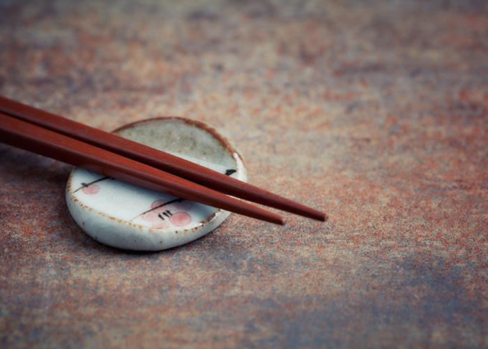 Hashioki, a Japanese chopstick rest made of ceramic with a pair of chopsticks resting on top