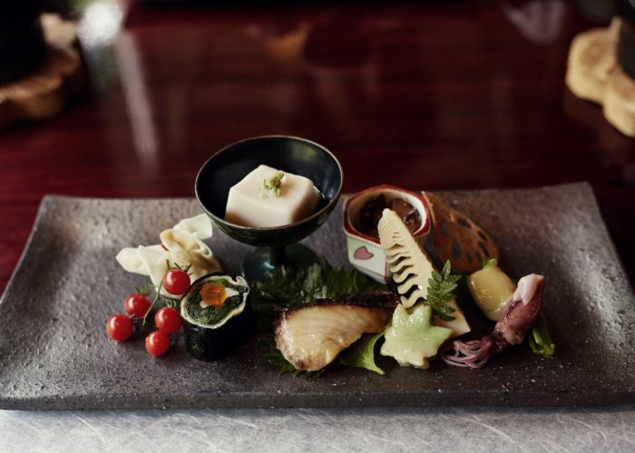 A rectangular platter with a variety of tofu, seafood and vegetables, part of a kaiseki meal in Kyoto, Japan