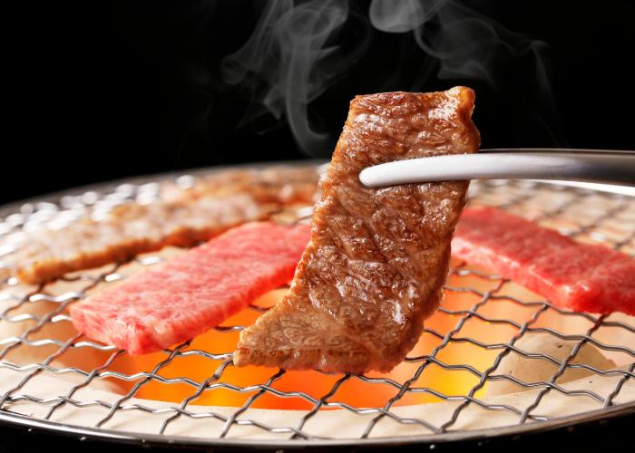 Yakiniku, Japanese BBQ, pieces of meat being grilled over coals